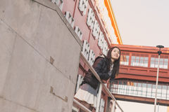 Young beautiful Chinese girl posing in the city streets Stock Photo