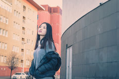 Young beautiful Chinese girl posing in the city streets Stock Image