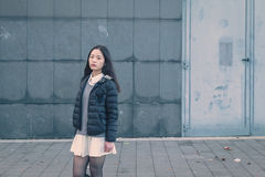 Young beautiful Chinese girl posing in the city streets Royalty Free Stock Images