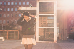Young beautiful Chinese girl posing in the city streets Royalty Free Stock Image