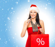 Young and beautiful Christmas shopper girl Stock Photos