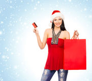 Young and beautiful Christmas shopper girl Royalty Free Stock Image