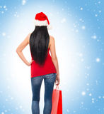 Young and beautiful Christmas shopper girl Stock Photo