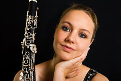 Young beautiful clarinetist Royalty Free Stock Images