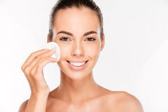 Young beautiful cleaning face with cotton pads stock photo