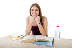 Young beautiful college student girl studying happy confident and positive Stock Photo
