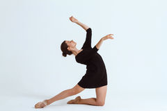 Young beautiful contemporary dancer posing over white background. Copy space. Royalty Free Stock Images