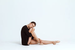 Young beautiful contemporary dancer posing over white background. Copy space. Stock Photo