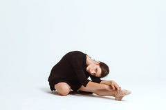 Young beautiful contemporary dancer posing over white background. Copy space. Royalty Free Stock Image