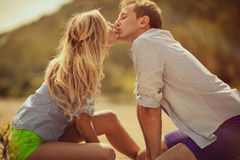 Young beautiful couple. Are kissing on the beach Stock Photos