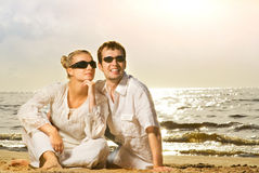 Young beautiful couple. Relaxing on the beach Royalty Free Stock Image