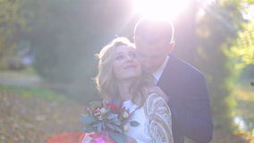 Young and beautiful couple in autumn park stock video footage