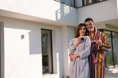 Young beautiful couple in bathrobes Stock Image