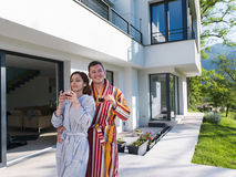 Young beautiful couple in bathrobes Royalty Free Stock Photos