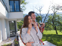 Young beautiful couple in bathrobes Royalty Free Stock Photography