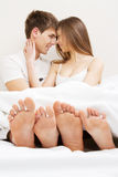 Young beautiful couple in bed Stock Photo