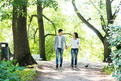 Young beautiful couple being on a date and having a walk stock image