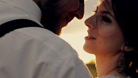 Young beautiful couple bride and groom close-up stock footage