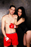 Young beautiful couple of brunette woman and handsome boxer man Stock Image
