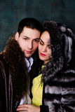 Young beautiful couple of brunette woman and handsome man in fur Royalty Free Stock Image