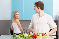 Young beautiful couple cooking at home Stock Photos