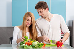 Young beautiful couple cooking at home Royalty Free Stock Photography