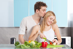 Young beautiful couple cooking at home Royalty Free Stock Photos