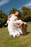Young beautiful couple dance and embrace on grass Royalty Free Stock Images
