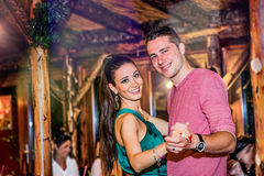 Young beautiful couple dancing in bar or club Royalty Free Stock Photos