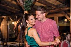 Young beautiful couple dancing in bar or club Stock Photos