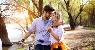 Young loving couple dating while riding bicycles in the city. Young beautiful couple dating while riding bicycles in the city Royalty Free Stock Images