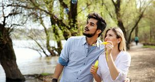 Young loving couple dating while riding bicycles in the city. Young beautiful couple dating while riding bicycles in the city Royalty Free Stock Photos