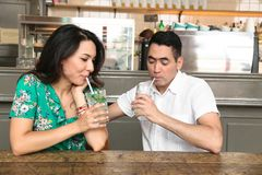 Young beautiful couple drinking coctail through straws royalty free stock photos