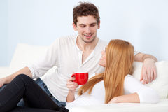 Young beautiful couple drinking coffee Stock Images