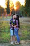 Young beautiful couple embracing and smiling at sunset in summer Royalty Free Stock Photos