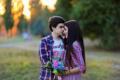 Young beautiful couple embracing and smiling at sunset in summer Royalty Free Stock Images