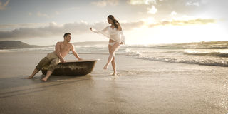 Young beautiful couple enjoying an afternoon at the beach Stock Photo