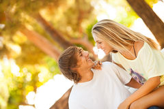 Young beautiful couple enjoying a day on the park Stock Photos