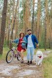 Young beautiful couple enjoying eco tourism together. Eco tourism. Young beautiful couple wearing stylish clothes feeling happy while enjoying eco tourism stock photo