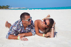 Young beautiful couple enjoying the sunset in luxury resort royalty free stock images