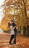 Young beautiful couple at fall. Young beautiful couple in the Luxembourg garden at fall. Paris, France royalty free stock photos