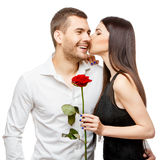 Young beautiful couple with flowers isolated on white Royalty Free Stock Image