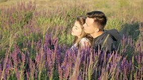 Young couple in the colors of the spring field stock video