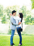 Young beautiful couple full length in the park Royalty Free Stock Photos