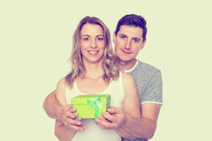 Young beautiful couple with gift box Royalty Free Stock Photos