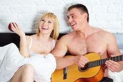 Young and beautiful couple with guitar Royalty Free Stock Photo