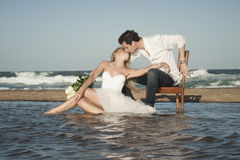Young beautiful couple hanging out together at the beach Royalty Free Stock Image