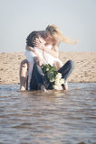 Young beautiful couple hanging out together at the beach Stock Photos