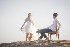 Young beautiful couple hanging out together at the beach Stock Photography