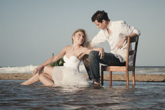 Young beautiful couple hanging out together at the beach Royalty Free Stock Photo